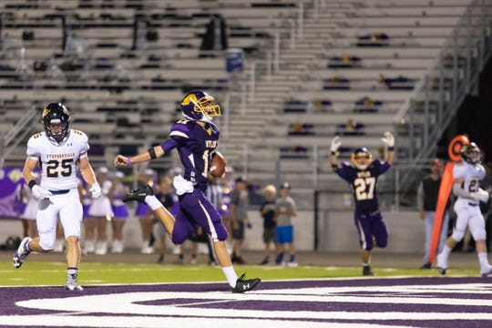 Wylie wide reciever Christian Ramirez  (11) runs into the end zone for a touchdown during the second half of a game against the Stephenville Yellow Jackets Friday evening.