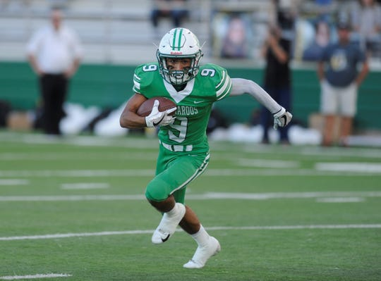 Breckenridge running back Angel Ruiz looks for space in his team's 34-13 loss to Cisco at Buckaroo Stadium on Sept. 14, 2018. Ruiz ran for 159 yards and two TDs.