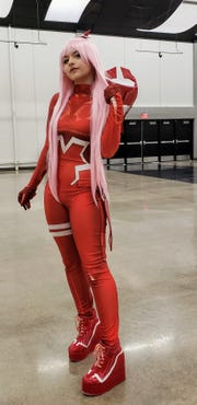 """Nikachu, one of the professional cosplayers at the Anime Sekai convention in Abilene, dressed as Zero Two from """"Darling in the FranXX."""""""
