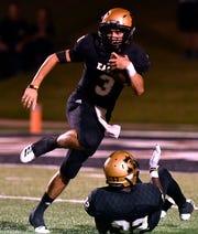 Abilene High quarterback Kallin Sipe scrambles with the ball during Friday's Crosstown Showdown against Cooper Sept. 14, 2018. Abilene won, 20-13.