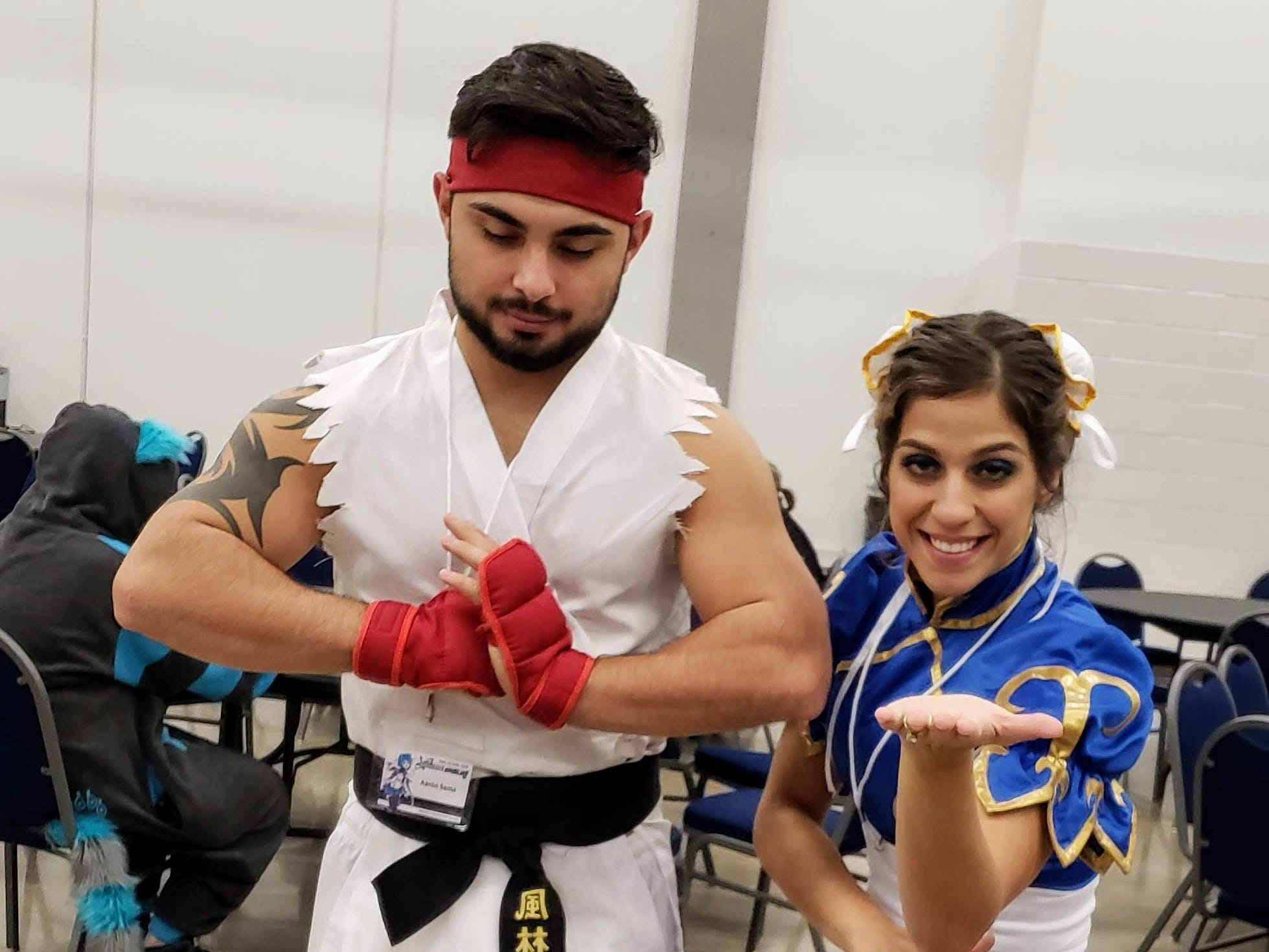 """Aaron and Kim Lopez, from Houston, show off their costumes of Ryu and Chun-Li from the popular """"Street Fighter"""" series of video games."""