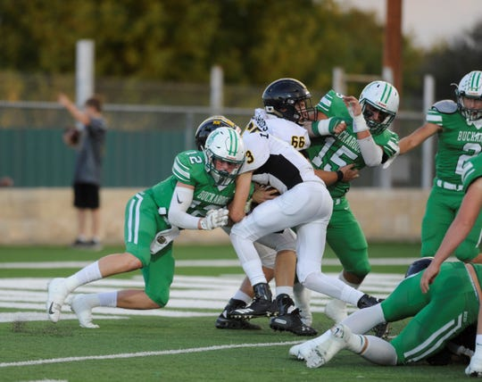 Cisco quarterback Cooper Witt (3) crashes into Breckenridge defensive back Owen Woodward (12) during a 1-yard TD score.