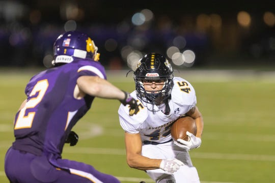 Stephenville running back Krece Nowak (45) anticipates as tackle from Wylie's Gus Davis (2) Friday evening during a nondistrict game at Bulldog Stadium.