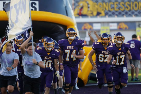 Wylie takes the field Friday before a nondistrict game against the Stephenville at Bulldog Stadium in Abilene.