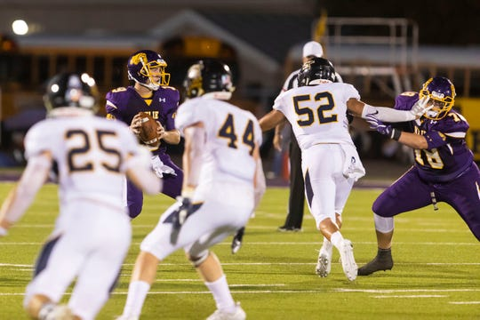 Wylie quarterback Harrison Atwood (19) looks for a receiver during the loss to Stephenville. The Bulldogs committed five turnovers in the 41-28 loss.
