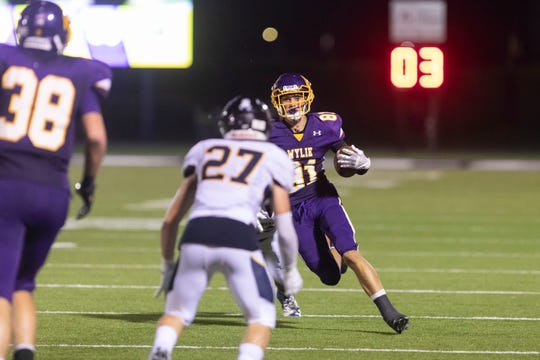 Wylie wide receiver Hayden Keidl (81) runs after a catch early in the season. Wylie makes its District 3-5A Division II debut at Wichita Falls Memorial Stadium on Friday night against Rider.