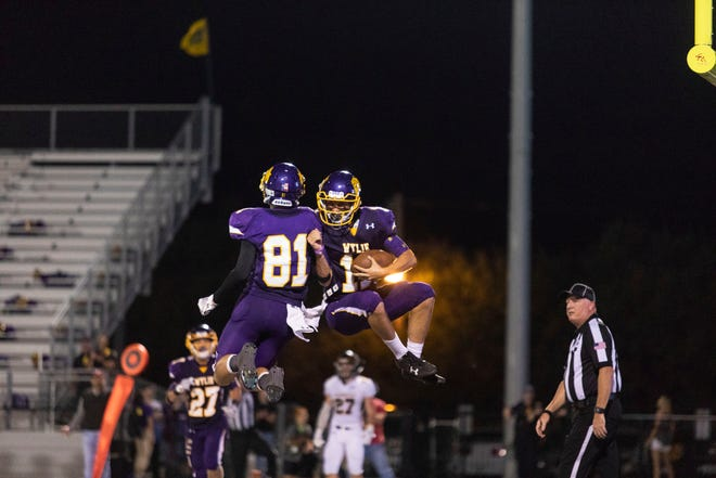 Wylie wide receiver Christian Ramirez (right) celebrates a touchdown with teammate Hayden Keidl Friday evening during a game against Stephenville at Bulldog Stadium in Abilene.