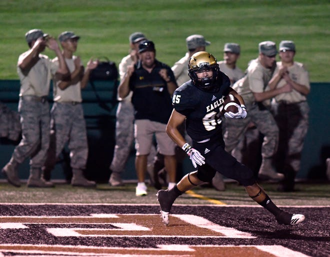 Abilene High's Michael Bartlett scores a touchdown during the second half of Friday's Crosstown Showdown against Cooper. Down 13-3 at halftime, Abilene High won, 20-13.