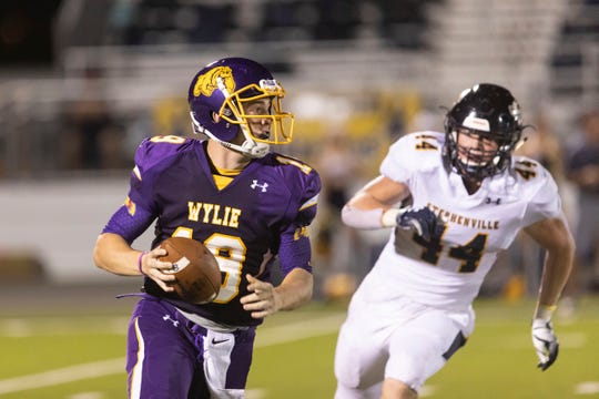 Wylie quarterback Harrison Atwood (19) looks to get rid of the ball as Stephenville's Blu Caylor (44) closes during a nondistrict game at Bulldog Stadium. The Bulldogs lost, dropping to 0-3 going into Thursday's game against Cooper.