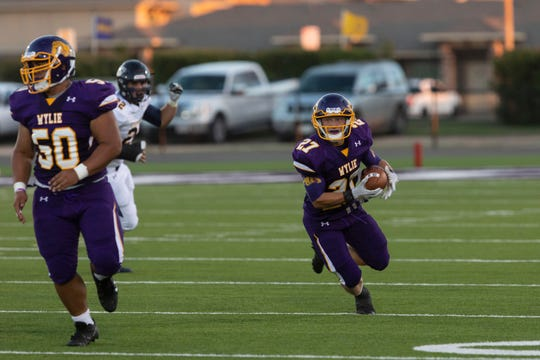 Wylie's Bailey Hicks (27) runs the ball on the Bulldogs first drive of the game against the Stephenville Yellow Jackets at Bulldog Stadium in Abilene.
