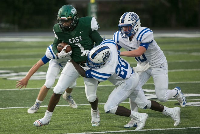 East Henderson's Zay Henderson runs the ball during Friday night's game against Polk at East Henderson.