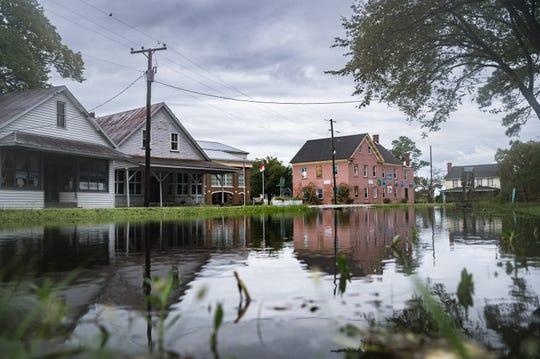 Front yards on Main Street in Swan Quarter, N.C, sit with moderate flooding Saturday Sept. 15, 2018, after Hurricane Florence made landfall on Friday morning.