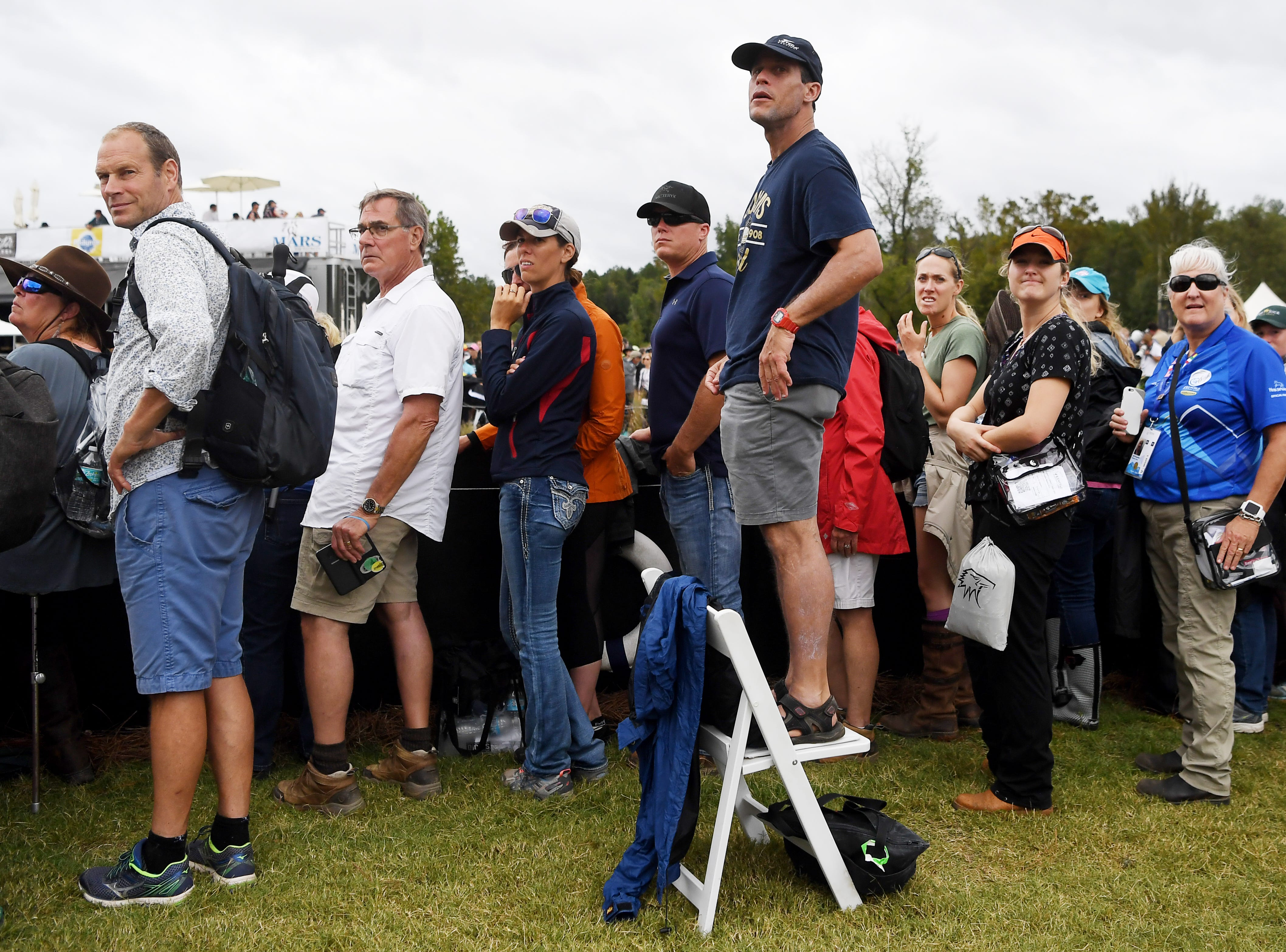 Spectators watch the cross country event on day four of the World Equestrian Games in Tryon Sept. 15, 2018.