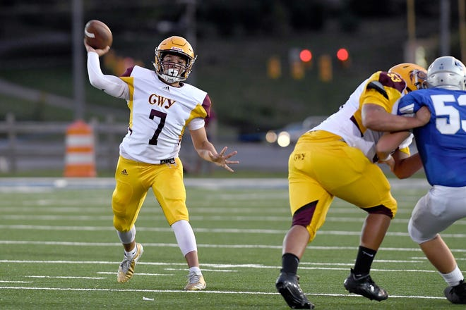 Cherokee quarterback Bobby Crowe throws a pass during a game at Smoky Mountain High School on Sept. 14, 2018.