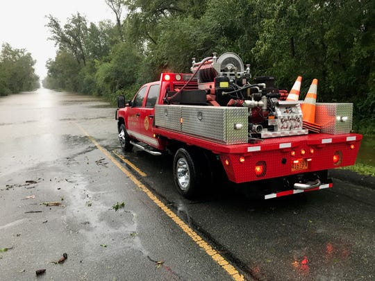 Emergency response is blocked by water covering N.C. 241 in Beulaville, North Carolina.