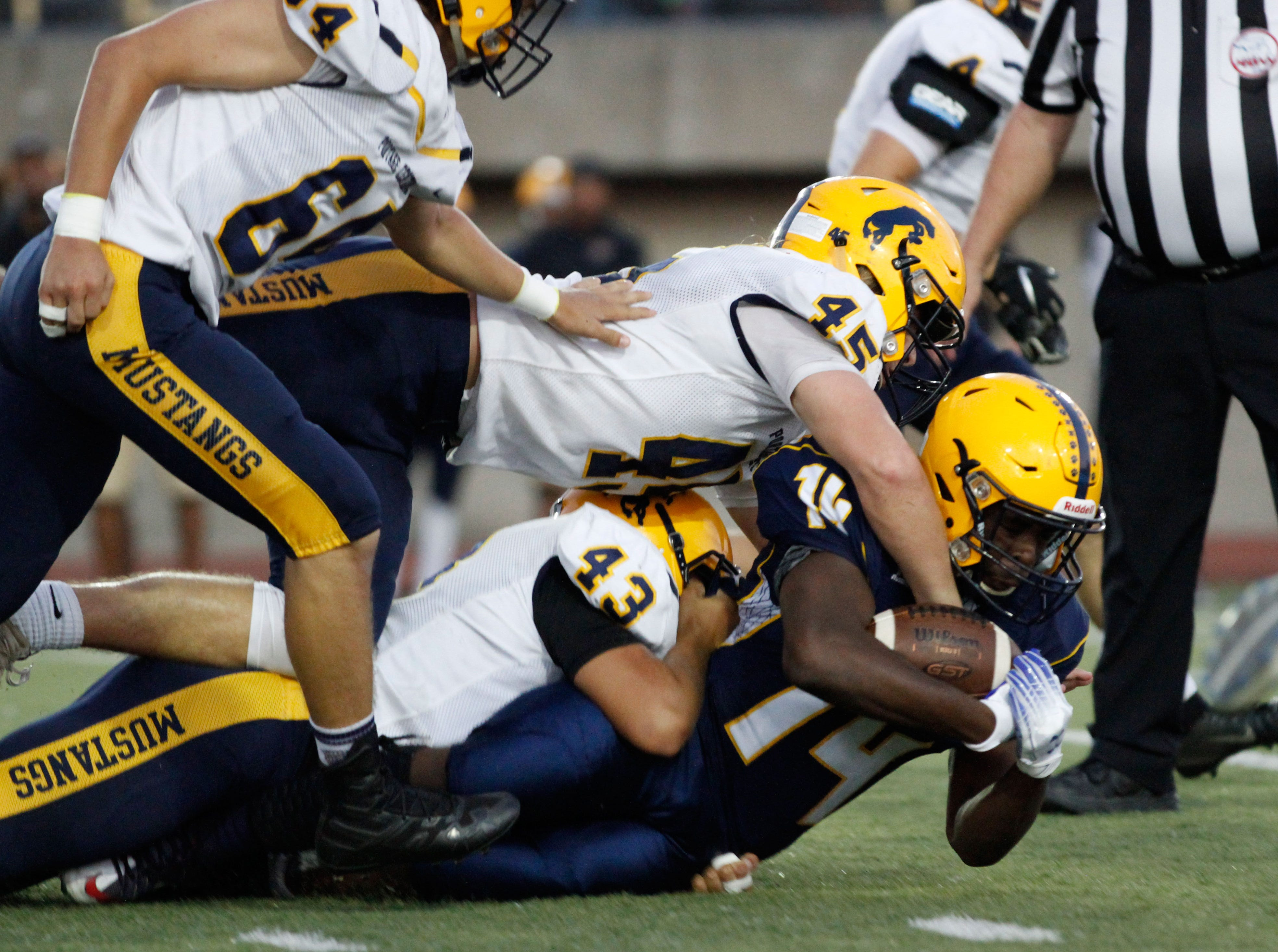 BCC's  Jaquan West stretches for some extra yards in this loss to Portage Central.