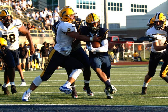 BCC's Josh Mann runs for some tough yards against Portage Central in first half action.