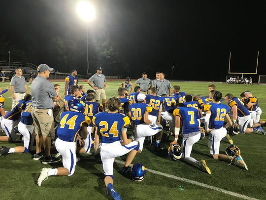 Coach Matt Gallagher addresses the boys following Friday night's win over Chenango Valley.
