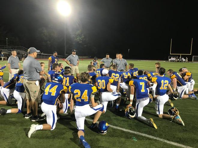 Coach Matt Gallagher addresses the boys following Friday night's win over Chenango Valley.