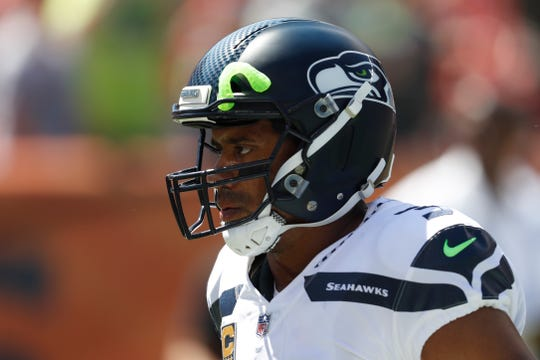 Seahawks quarterback Russell Wilson  says he remains focused on the season, despite a Sports Illustrated article alleging a locker room rift in 2017.