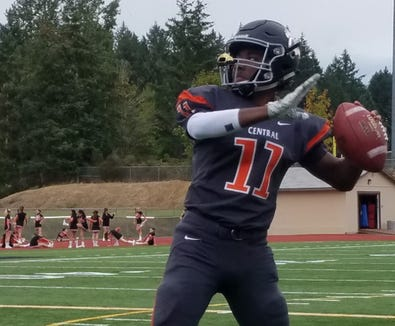 Central Kitsap quarterback Elijah McGee warms up before Friday's game against Yelm.