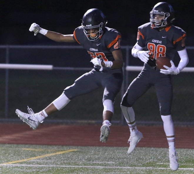 Central Kitsap's Jason Almonte (right) and Jeven Keel celebrate a touchdown during the Cougars' 30-28 win over Yelm on Friday night at Silverdale Stadium.