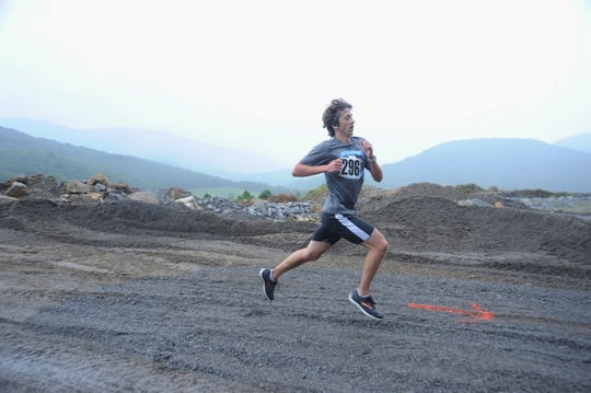 Third-place overall finisher Derrick Nowak, of Asheville, zips into the quarry on Sept. 15, during the Rock the Quarry Trail Challenge 5K and Kids Fun Run.