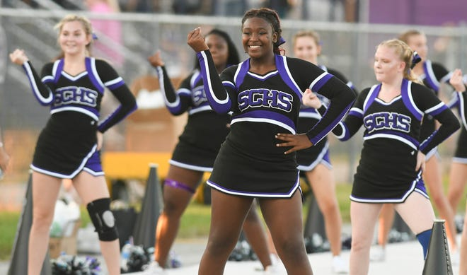 Space Coast cheerleaders dance during Friday's game.