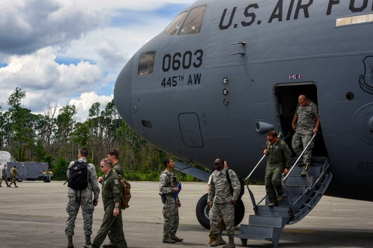 Airmen with the 920th Rescue Wing at Patrick Air Force Base exit a C-17 Globemaster III Friday at Moody Air Force Base in Georgia.