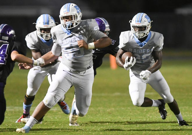 Jordan Young-Humphrey of Rockledge (22) runs the ball during Friday's game against Space Coast.