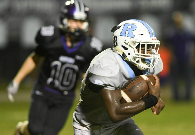 Ladarius Tennison runs the ball during a game against Space Coast.