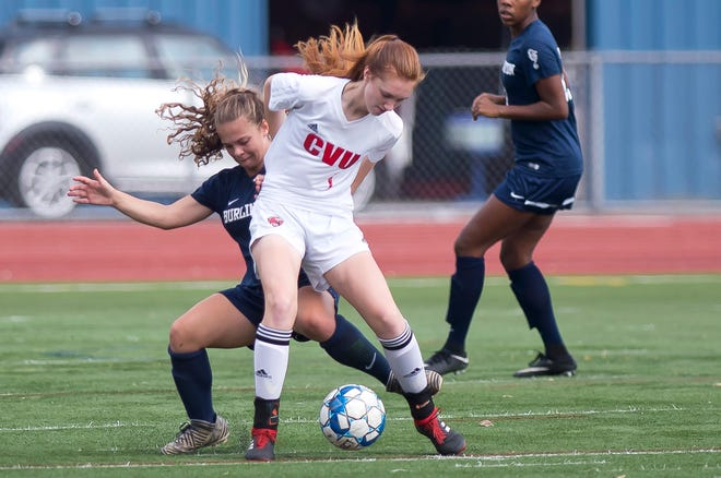 Burlington's Maggie Barlow, left, tries to win the ball off Champlain Valley's Catherine Gilwee during Saturday's high school girls soccer game at Buck Hard Field on Sept. 15, 2018.