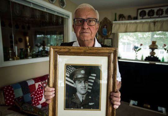 Glendon K. 'Jack' Fleury, approaching 90, of Colchester, holds a photo of Elwin McMahon, who he says is his brother. Both stayed at the St. Joseph's orphanage as kids.