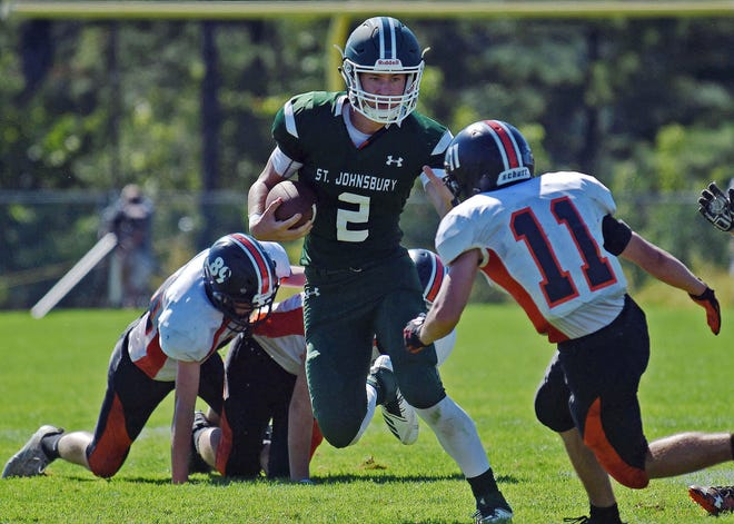 St. Johnsbury quarterback Jake Cady slices through the Middlebury defense during the Hilltoppers' 44-32 win in a Division I game at Fairbanks Field on Saturday