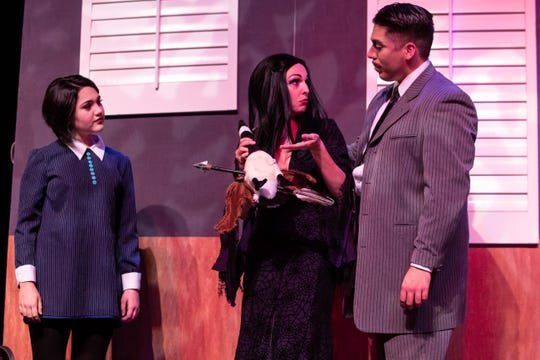 Wednesday Addams played by Eliot Ruiz, Morticia Addams played by  Angela Cirino and  Gomez Addams played by Frank Garcia Jr. in the Harbor Playhouse's production of Addams Family running from Sept. 21 - October 31st.