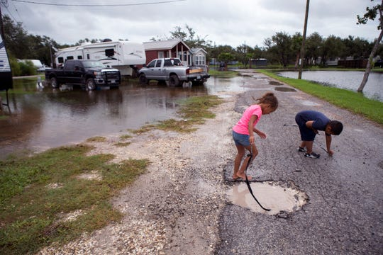 Laila Hill (left), 6, and Rudy Garcia, 5, play at the Raintree RV Park in Rockport on Saturday, September 15, 2018. Residents of the park were stuck in their homes due to high water.