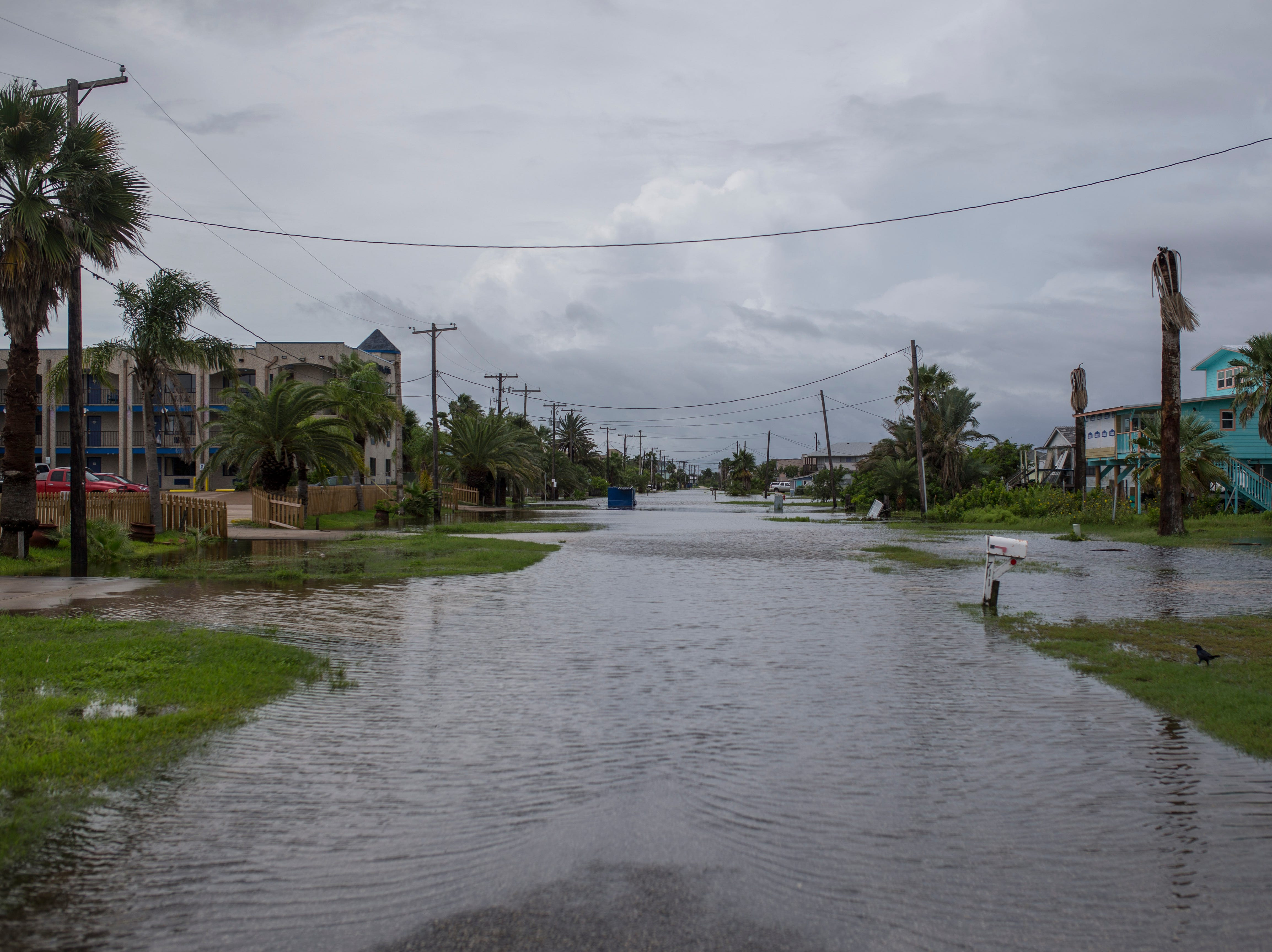 Water sits above South Magnolia street in Rockport, Texas on Saturday, Sept. 15, 2018.