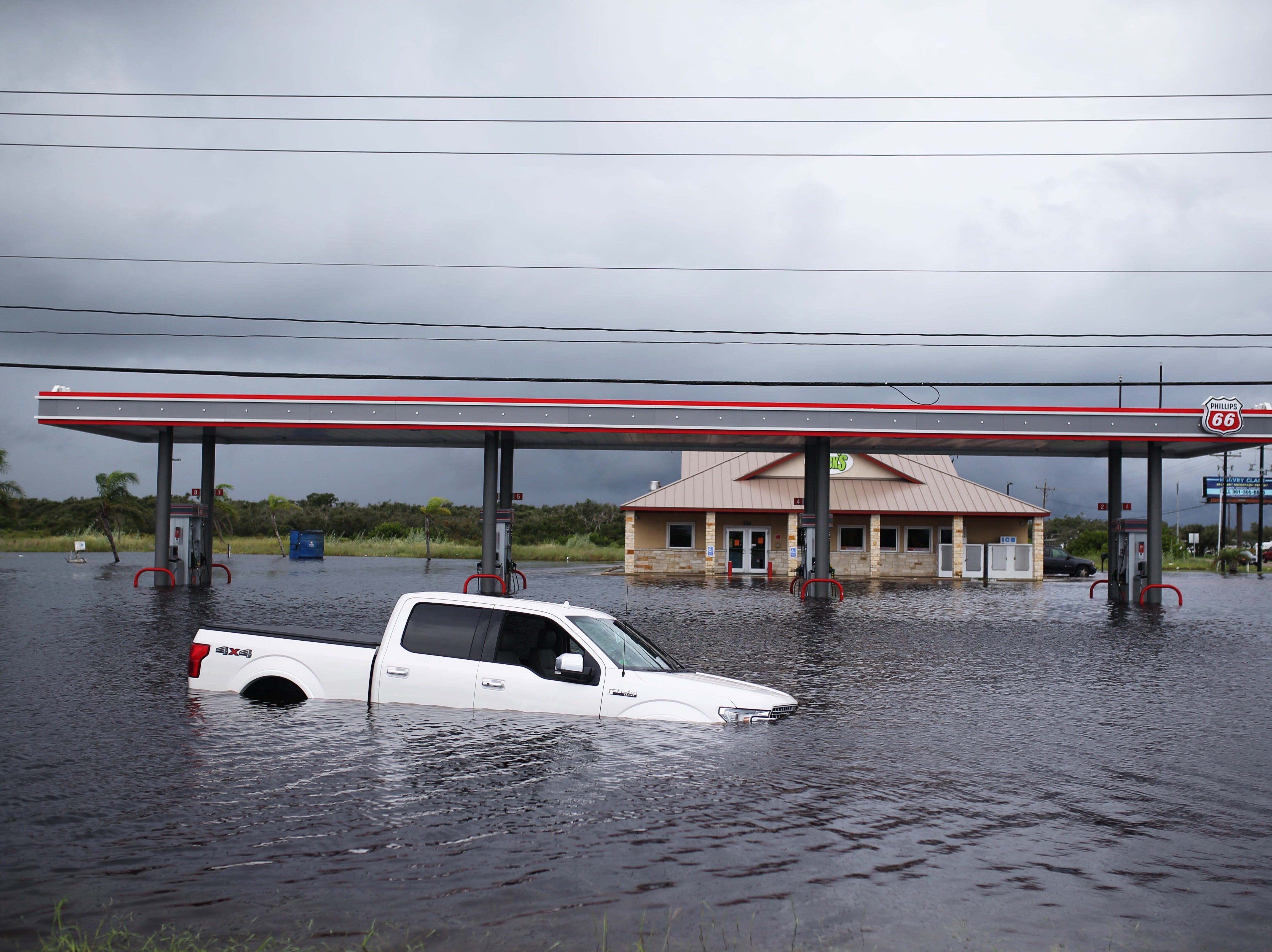 A truck is stalled out in water on Business State Highway 35 and State Highway 188 between Rockport and Aransas Pass on Saturday, Sept. 15, 2018.