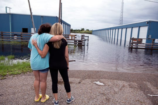 TLC Storage manager Miki Chavez (left) hugs renter Sally Bywaters as the facility is flooded in Rockport following heavy rains on Saturday, September 15, 2018. Bywaters stores antiques at the storage facility and had just moved contents of her home to the facility to begin repairs on her home from Hurricane Harvey. The facility is still undergoing repairs from the hurricane and is about 50 percent done. Chavez estimates there is about a foot of water in the units.
