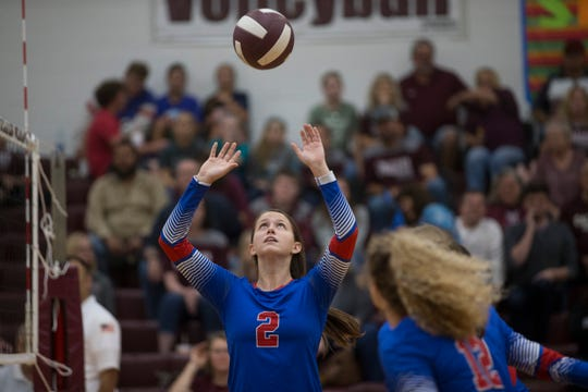 Gregory-Portland's Samantha Kuzma sets the ball against Calallen in their 29-5A volleyball match on Friday, Sep. 14, 2018 at Calallen High School.