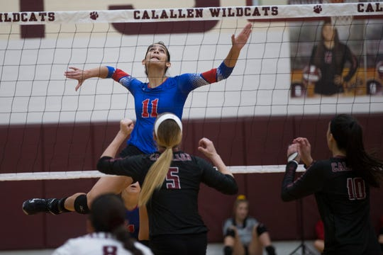 Gregory-Portland's Chloe Rodriguez spikes the call against Calallen in their 29-5A volleyball match on Friday, Sep. 14, 2018 at Calallen High School.