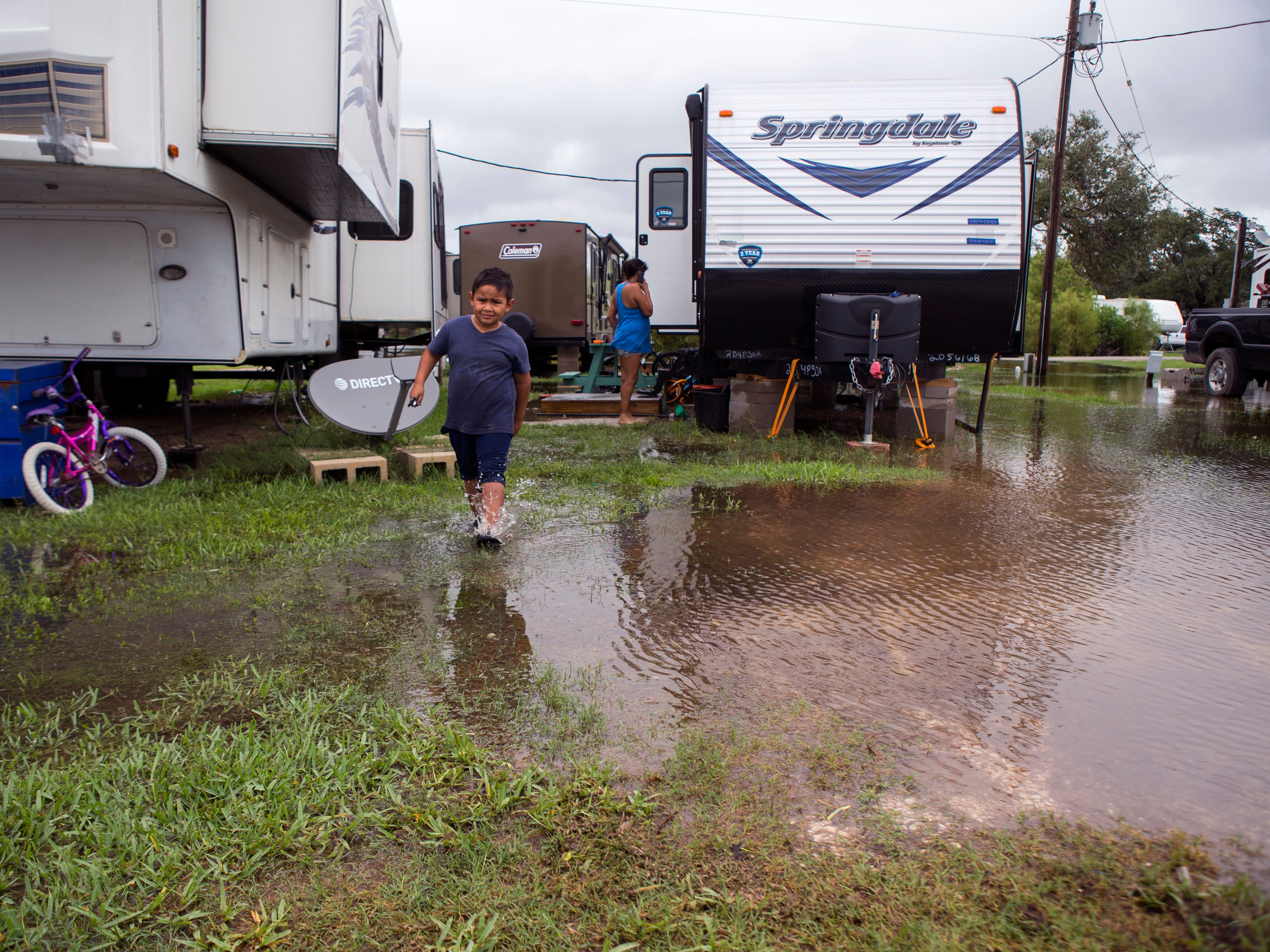Rudy Garcia, 5, plays at the Raintree RV Park in Rockport on Saturday, September 15, 2018. Residents of the park were stuck in their homes due to high water.
