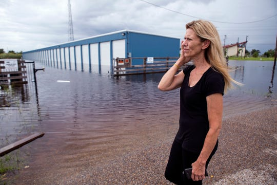 Sally Bywaters looks at the TLC Storage in Rockport, which was flooded on Saturday, September 15, 2018. She stores antiques at the storage facility and had just moved contents of her home to the facility to begin repairs on her home from Hurricane Harvey. The facility is still undergoing repairs from the hurricane and is about 50 percent done. The manager estimates there is about a foot of water in the units.