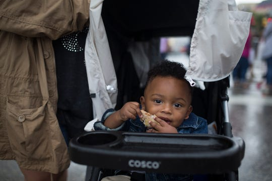 Andrew Shockley, 1, eat tacos at the Que Bueno Taco Fest in Corpus Christi on Saturday, Sept. 15, 2018.