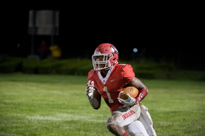 Lenape's Xavier Coleman carries the ball against Vineland in a 17-14 win on Sept. 14. The Indians are one team that's benefited from the state's new power ranking formula.