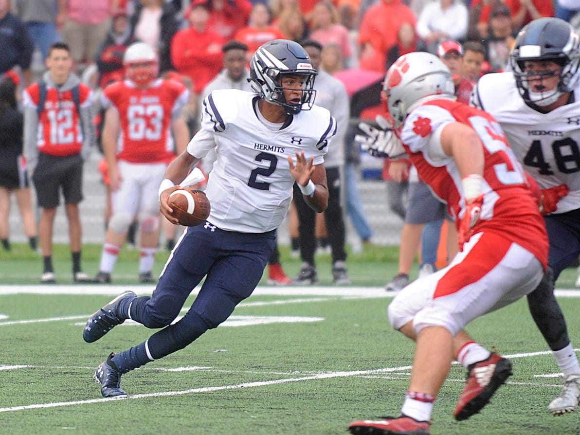 St. Augustine QB, Chris Allen (2) runs the ball against St. Joseph. The visiting Wildcats rolled past the Hermits 30-8 on Friday, September 14.