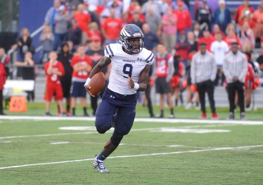 St. Augustine WR, Jaylen DeCoteau (9) runs for a short gain against St. Joseph. The visiting Wildcats rolled past the Hermits 30-8 on Friday, September 14.