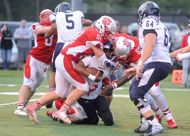 St. Joseph DE, Bobby Hyndman (51) and Sean Morris DT, (53) take down St. Augustine QB, Chris Allen. The visiting Wildcats defeated the Hermits 30-8 on Friday, September 14.