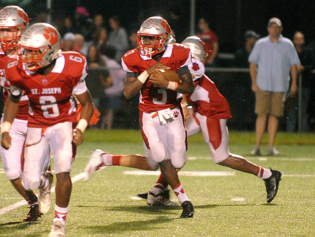 St. Joseph RB, Jada Byers (3) runs for a gain against St. Augustine on Friday, September 14.
