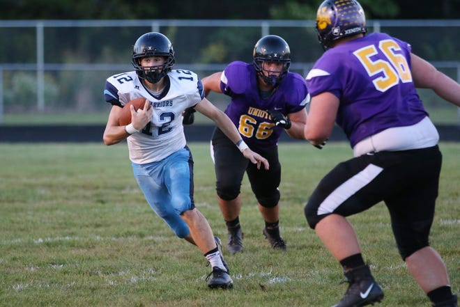 Adena quarterback Preston Sykes runs the ball during a 33-15 loss to Unioto in 2018 at Unioto High School.